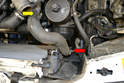 With the upper hose removed use a flathead screwdriver and remove the clamp and hose from the middle left side of the radiator (red arrow) to the coolant pump (yellow arrow).
