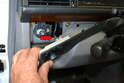 Pull the trim piece away from the dash and disconnect the light from the headlight switch indicator (red arrow).