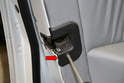 Use a Philips head screwdriver and remove the single screw holding the door latch trim piece in place.