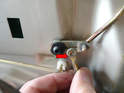 With the clip removed you can separate the rods from the hinge (red arrow).