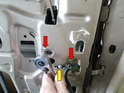 Use your 8mm socket to unscrew the two bolts (yellow arrows) that hold the element to the door frame.