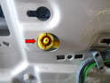 Remove the vacuum line (red arrow) from the base of the lock while the mechanism is still in the door.