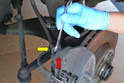 Begin by cleaning the area around the bleed screw (red arrow) with some brake cleaner and a wire brush if necessary.