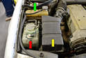 The windshield washer fluid reservoir is located in the front right corner of the engine compartment (red arrow).