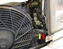 Condenser- Use a 19mm wrench (red arrow) and a 17mm wrench (yellow arrow) to undo the second A/C line.