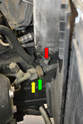 On the left side of the condenser there is a small bracket that attaches the hard lines to the frame.