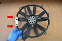 If you are replacing the left side fan make sure to change over the mounting bracket and the two 8mm bolts (red arrows).