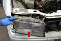 Headlight Removal- Slide the headlight unit forward (red arrow).