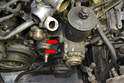Remove the two 13mm nuts and bolts (red arrows) holding the power steering pump and reservoir to the mount.