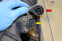 Turn the locking ring on the harness (red arrow) counter clockwise; this will separate it from the connection on the MAF (yellow arrow).