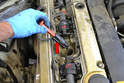 Pull the spark plug connectors up by the hard plastic part (red arrow).