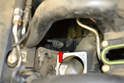 Above Method- With the throttle body off you can easily access the 13mm nut and the sensor (red arrow).