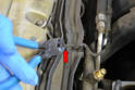 Cut the zip ties on the wiring harness to give you room to move them (red arrows).