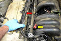 Move the wiring and tray out of the way towards the top of the engine (red arrow).