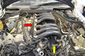 Wiggle, lift and pull the intake manifold from the head (red arrow) and the two openings on the lower intake manifold (yellow arrow, one shown).