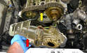 Gently pull the timing chain cover away from the head (red arrow).