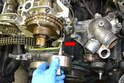 Use Mercedes-Benz tool #116 589 20 33 00 and remove the guide pin for the intake chain rail (red arrow).