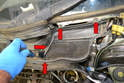 ': Wiper Assembly-Use a Philips head screwdriver and remove the four screws (red arrows) on both pieces.