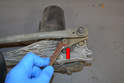 Wiper Assembly- Use a 13mm wrench and remove the nut holding the motor to the swing arm (red arrow).