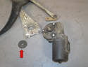 Wiper Assembly- Remove the large rubber washer from the motor and separate it from the arm (red arrow).