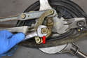Wiper Assembly- Use a 17mm wrench and remove the nut holding the swing arm to the mono-post (red arrow).