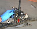Wiper Assembly- A puller is sometimes needed to separate the swing arm from the mono-post (red arrow).