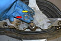 Wiper Assembly- With the swing arm off gently pry away the circlip (yellow arrow) and the washer from the post on the mono-post.