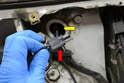 If you have an air bag in place of the glove box it is possible to gently pull the wiring up enough until you can grab the connection with a set of needle nosed angle pliers through the hole (yellow arrow).