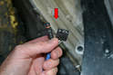 The factory O-2 sensors have a single plug and three pin connections (red arrow).