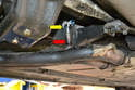Working on the exhaust before the catalytic converter you will find the single O-2 sensor (red arrow) and the wiring that runs to the interior of the car (yellow arrow).