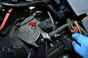 The brake light switch is located on the brake pedal mounting bracket.