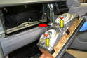 Tilt the unit forward and remove the main wiring harness from the clip on the back of the unit (red arrow) and then the two orange connections (yellow arrows).