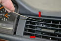 Center Vents: Pull the two clips on the left side of the vent down in the same manner as the side vents (red arrows).