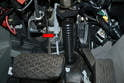 Some vehicles have the speedometer cable clipped to the pedal box (red arrow).