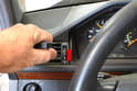 Turn the handle so that the hooked end is facing the instrument cluster (red arrow).