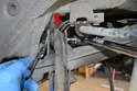 Remove the old hardware from where the Pull link joins the chassis (red arrow) and then from where it joins the hub.