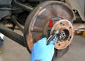 Remove the caliper, rotor and parking brake.