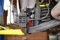 There is a rubber flexible brake hose that connects the hard brake line (yellow arrow) to the caliper (red arrow).