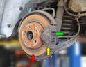 You will need to remove the brake pads (green arrow) and caliper (yellow arrow) to change the rotor (red arrow).