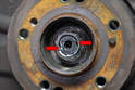 The end of the axle shaft that has two cut outs in it (red arrows).