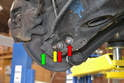 These are the four nuts and bolts you will need to remove in order to perform this job: control arm to wheel carrier (green arrow), drop link (yellow arrow) and shock (red arrows).