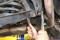 Using two 19mm sockets remove the nut holding the control arm to chassis but do not remove the bolt yet.