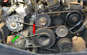 This photo illustrates the five different belts on the W126 (there are two belts on the water pump, power steering pump).