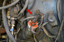 Remove the wire from the coil (red arrow) and feed it back through the engine bay so it can be removed with the distributor cap.