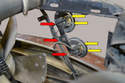 This photo illustrates the wires (yellow arrows) that you can use to make sure the horns are getting a signal, and the 13mm nuts (red arrows) securing the horns to their brackets.