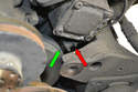 The sensor (red arrow) detects when the engine is a top dead center by a small metal nodule (green arrow) mounted on the vibration dampener passes it.