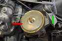Replace the dust seal on the distributor (red arrow) while you are there, it simply lifts off the distributor.