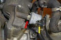 This photo illustrates the electrical connector (yellow arrow) and where the sender (red arrow) screws into the oil filter housing.