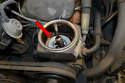 Use a turkey baster or small hand pump and remove as much fluid from the reservoir (red arrow) as possible.
