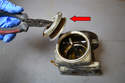 With the clip and spring removed use a set of needle nose pliers and remove the old filter (red arrow).